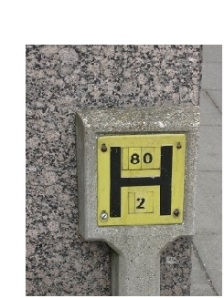hydrant sign on concrete post